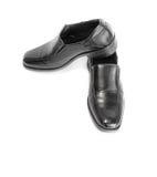 Black leather shoe. Isolated on white background Stock Images