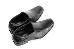 Black leather shoe. Isolated on white background, Rear view black shoes. select focus front shoe Royalty Free Stock Photos