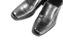 Black leather shoe on white background. Black leather shoe isolated on white background Royalty Free Stock Photography