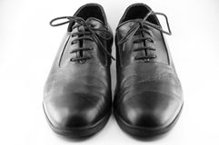 Black leather shoes. A pair of black leather shoes for man isolated Stock Photo