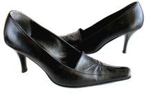 Black leather shoes. Elegant black leather high-heeled shoes on white background Stock Image