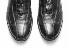 Black leather shoes against white background. Isolated black shoes without lace Stock Photo