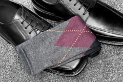 Black leather shoes with Argyle socks. A pair of black leather dress shoes with argyle socks Royalty Free Stock Photography