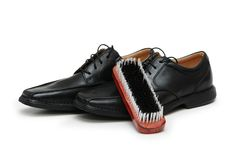 Black leather shoes and brush. Black leather shoes and  brush isolated on white Royalty Free Stock Photo