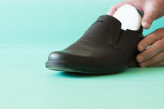 Black leather shoes with orthopedic insoles. Neutral background. Stock Photo