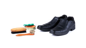 Black leather shoes and polish equipments Royalty Free Stock Image
