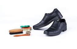 Black leather shoes and polish equipments Royalty Free Stock Photo