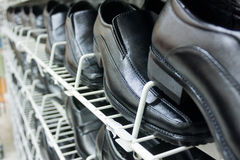 Black Leather Shoes On Shelves In Perspective View Stock Images