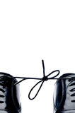 Black leather shoes with thier laces tied together Royalty Free Stock Photos
