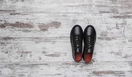 Black leather sneakers on a light laminate. Place to place your text royalty free stock images