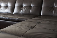 Black leather sofa. Closeup of luxurious expensive black leather couch Stock Images