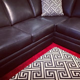 Black leather sofa Stock Photography
