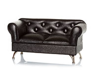 Black leather sofa. Couch isolated Royalty Free Stock Image