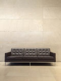 Black leather sofa on the ground Royalty Free Stock Image