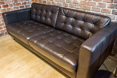 Black leather sofa. Sofa for interior design in a room Royalty Free Stock Image