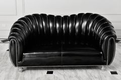 Black leather sofa in living room royalty free stock images