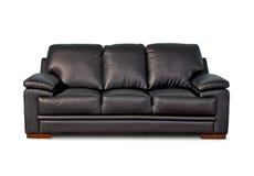 Black leather sofa. Isolated on white background Stock Photos