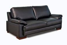 Black leather sofa. Isolated on white background Stock Image