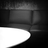 Black leather sofa and white table Stock Image