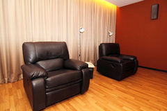 Black Leather Sofas. In a room at foot reflexology spa center Stock Photo