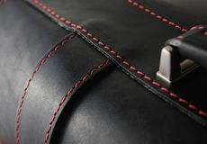 Black leather stitched with red thread. Black leather stitched in red coarse thread Royalty Free Stock Photo