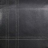 Black leather stitched thread vertically and Stock Photography