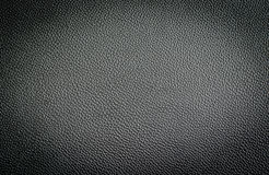 Black leather texture from car seats. On background Stock Photos