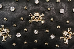 Black leather texture with metal skulls Stock Photography