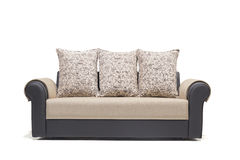 BLACK LEATHER THREE SEATER WITH GOLDEN COVERS WITH WHITE BACKGROUND. Grey three seater sofa with cushions on it royalty free stock photography