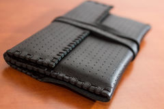 Black Leather Tobacco Pouch. Made of natural leather for storage of tabacco bags Stock Photography