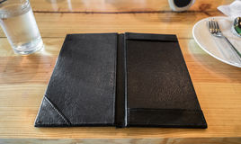Black leather tray blank space payment bill on table Stock Photos