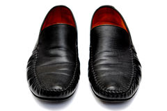 Black leather. Used shoes for men isolated on a white background.Horizontal close up shot Stock Photo