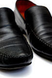 Black leather. Used shoes for men isolated on a white background.Horizontal close up shot Stock Image