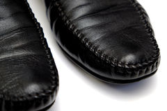 Black leather. Used shoes for men isolated on a white background.Horizontal close up shot Stock Images