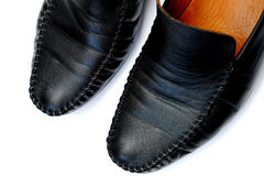 Black leather. Used shoes for men isolated on a white background.Horizontal close up shot Royalty Free Stock Image