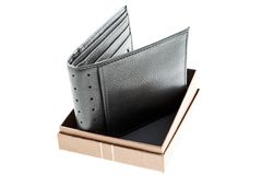 Black leather wallet in a box Stock Images