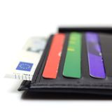 Black leather wallet with credit cards and money Stock Photo