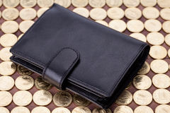 Black leather wallet on golden coins Royalty Free Stock Photography