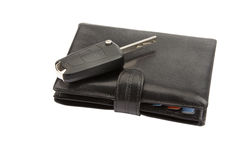 Black leather wallet and key. On white with clipping path Royalty Free Stock Photos