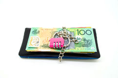 Black leather wallet with lock and some banknote Stock Image