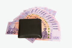 Black leather wallet and money Royalty Free Stock Photos