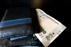 Black leather wallet with new indian currency Royalty Free Stock Photo