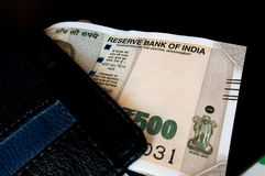 Black leather wallet with new indian currency Royalty Free Stock Images