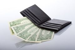 Black leather wallet with one dollar banknotes Stock Photography
