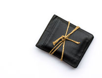 Black leather wallet with ropes on white background.The concept Royalty Free Stock Images