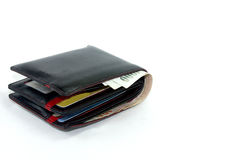 Black leather wallet with Thai currency isolated white background Royalty Free Stock Photos