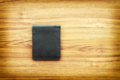 Black leather wallet on wooden background Stock Image