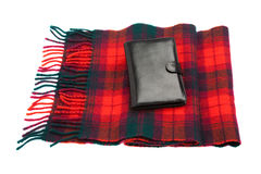 Black leather wallet and wool tartan scarf royalty free stock photos