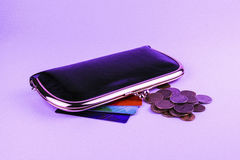 Black leather women`s purse next to which colored discount cards Royalty Free Stock Photo