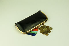 Black leather women`s purse next to which colored discount cards Stock Image